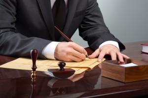 Lawyer at desk preparing case files